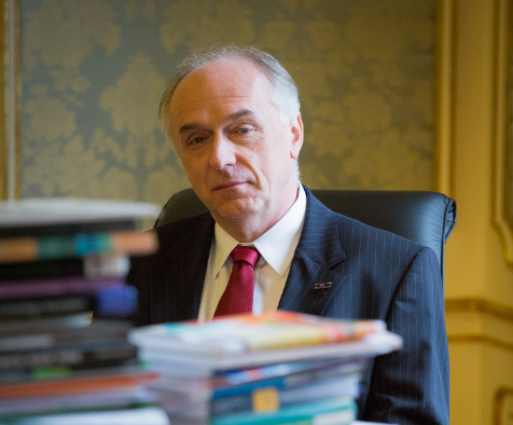 Portrait Photo of Pavel Kabat with books
